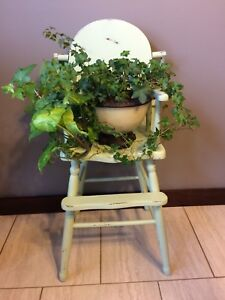 Fully functioning antique highchair solid wood
