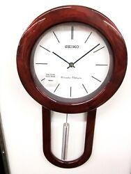 SEIKO WALL CLOCK WITH A ROUND DIAL & SLEEK PENDULUM  QXH057BLH