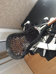 Boys lacrosse stick and gloves