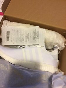 Brand new Adidas NMD R1 Triple White