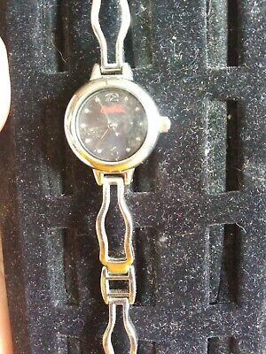 Coca Cola Ladies Watch-Shiny Silver face-Band looks like coke bottles-(Z6)