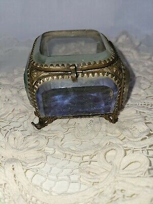 Antique French glass box for jewelry and small items from the early 20th century Collection of vintage jewelry boxes on the ladies/' table.