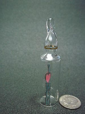 "Glass Ampule with "" I (Heart Shape) Mom "" Inside It"