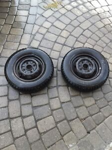 Two winter tires with steel rims  $50 both.