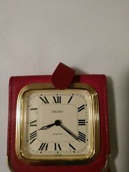 VINTAGE SEIKO QUARTZ TRAVEL ALARM CLOCK RED LEATHER FOLDING CASE - NEW
