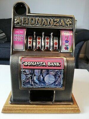 VINTAGE BONANZA BANK SLOT MACHINE..WOOD/METAL..GOOD CONDITION IN WORKING ORDER