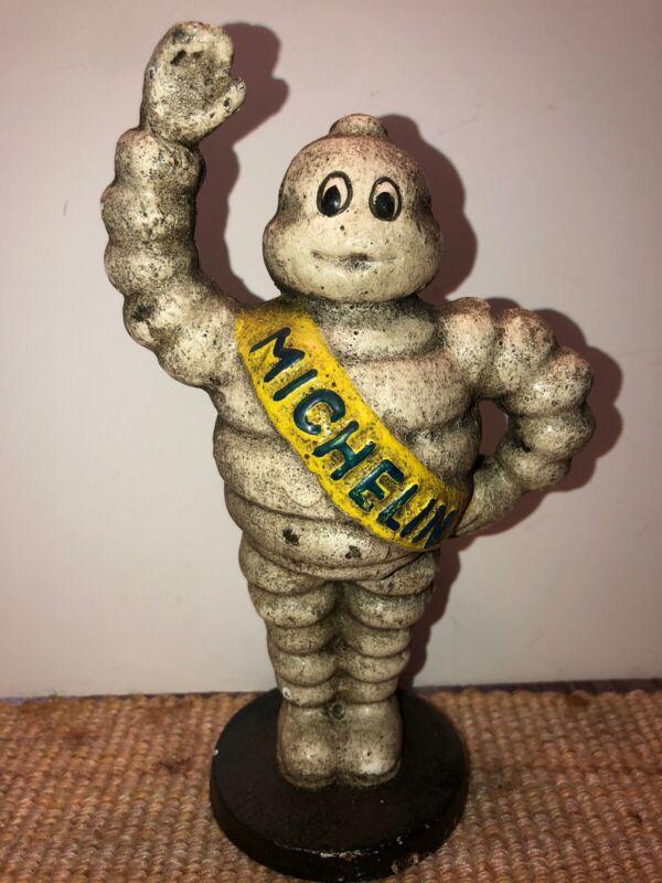 "Cast-Iron ""Michelin Man"" Penny Bank ."