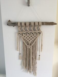 Macrame wall hanging on driftwood with beads