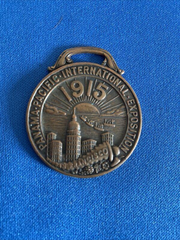1915 PANAMA PACIFIC EXPO BRONZE WATCH FOB