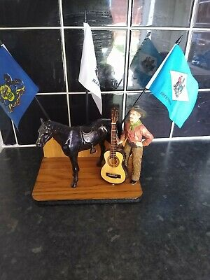 Spelter Horse On wood handmade stand including hard rubber cowboy flags guitar