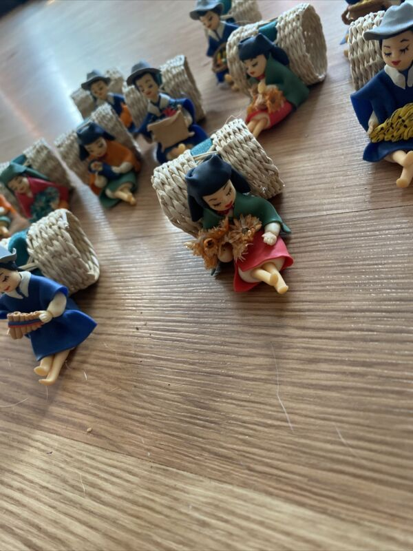 Lot Of 12 vintage wicker napkin rings with oriental figurines- Different Designs