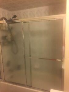 2 sets of sliding shower doors