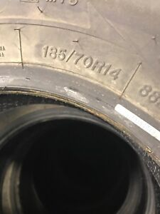 Four used 185/70/14 used winter tires