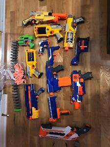 Nerf gun lot, 10 with attachments and some bullets