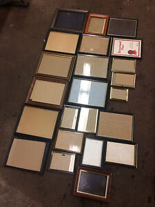Assorted picture frames, pictures, native artwork, John Wayne.