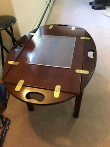 Coffee table with side flaps