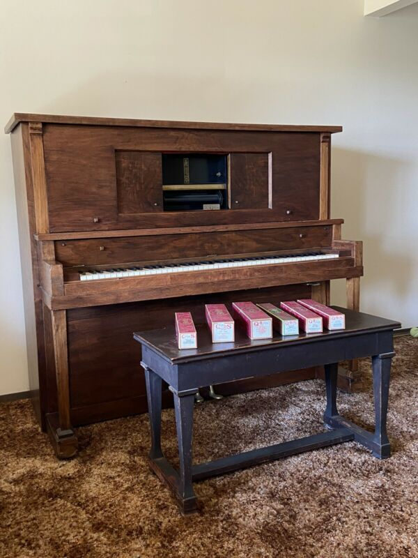 Upright Player Piano with rolls