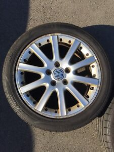 17x7 OEM VW rims with Momo Outrun M3 tires