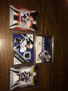 4 jersey hockey cards.