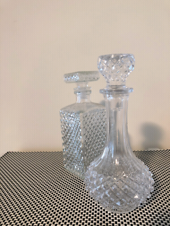 Two glass carafes