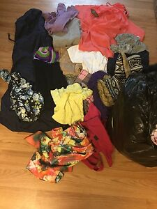 Large garbage bag of brand name women's clothes