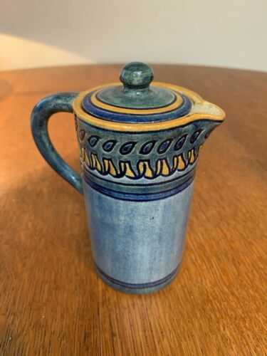 high glaze Newcomb pitcher with yellow lid