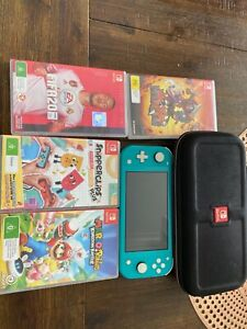 Nintendo switch lite with extra memory 32 b plus games