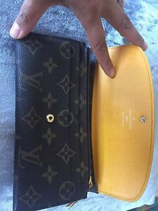 Authentic Louis Vuitton Emilie wallet in yellow