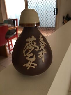 Japanese sake bottle and cup.