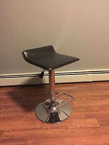 Brown leather and stainless steel bar stool