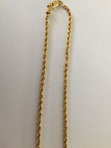 23 CT YELLOW GOLD NECKLACE.