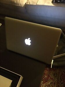 "Apple MacBook 13"" 2.4GHz Intel Duo"