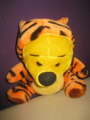 small winnie the poo soft toy with tigger hoodie on poo bear