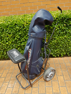 Golf clubs, bag and buggy. Arnold Palmer