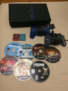 PS2 with 2 Controllers, 2 Memory Cards and 7 Games.