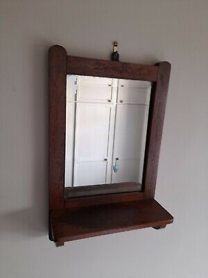 small, vintage, oak wall mirror, with shelf.