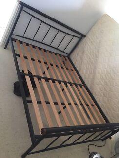 Black metal queen bed