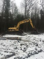 Excavator and operator for hire.