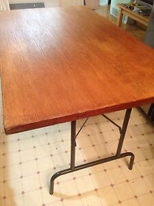 Folding table with solid hardwood top