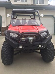 2011 Polaris 800 RZR-S with CAMOPLAST t4s tracks included.