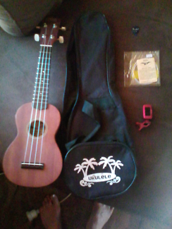Ukulele Thailand with case, tuner, and extra strings