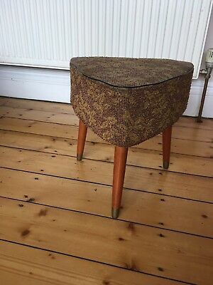Small retro vintage stool with wooden legs and material seat