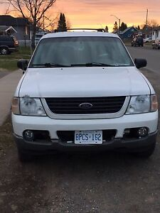 TWO 2002 Ford Explorers
