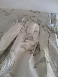 Total block out , pair of pencil pleat curtains