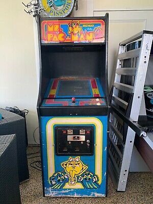 Classic 1982 Ms. Pac Man arcade machine with manual and speed chip