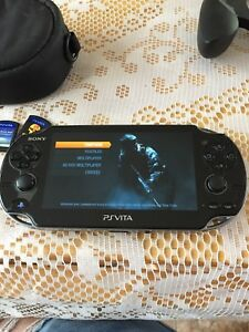 Ps vita with seven games and accessories