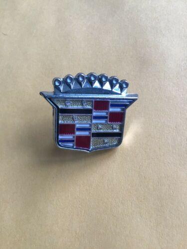 Vintage Cadillac NOS  emblem for dash?
