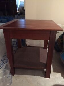 Two brown wood end tables