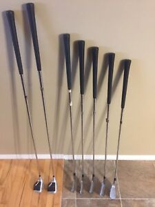 Assorted golf clubs