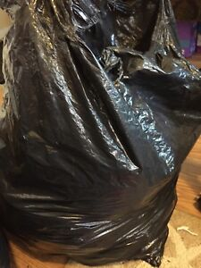 Garbage bag full of clothes